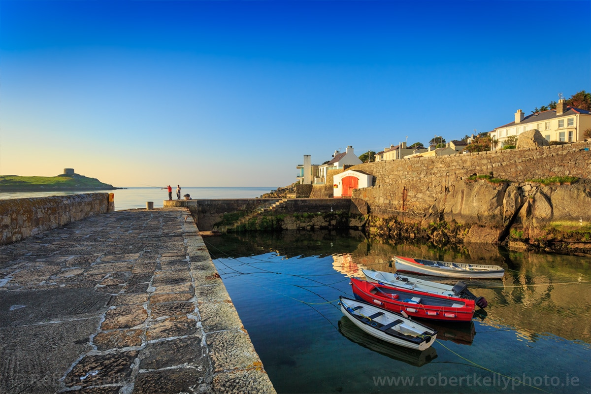 Fishing at Coliemore Harbour Dalkey in the early morning