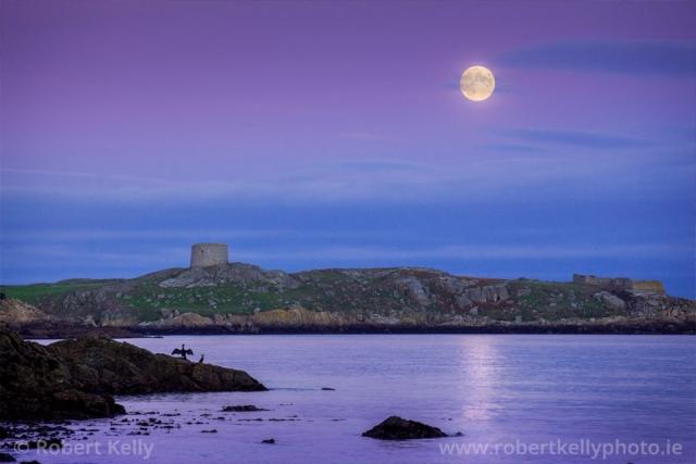 A full moon rises over Dalkey Island, County Dublin