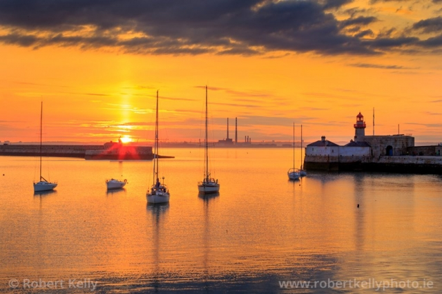 The sun sets over Dun Laoghaire Harbour and Dublin Bay