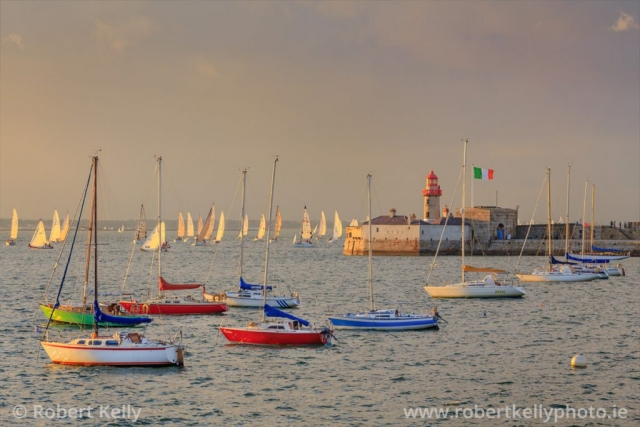Yachts returning to Dun Laoghaire Harbour at sunset