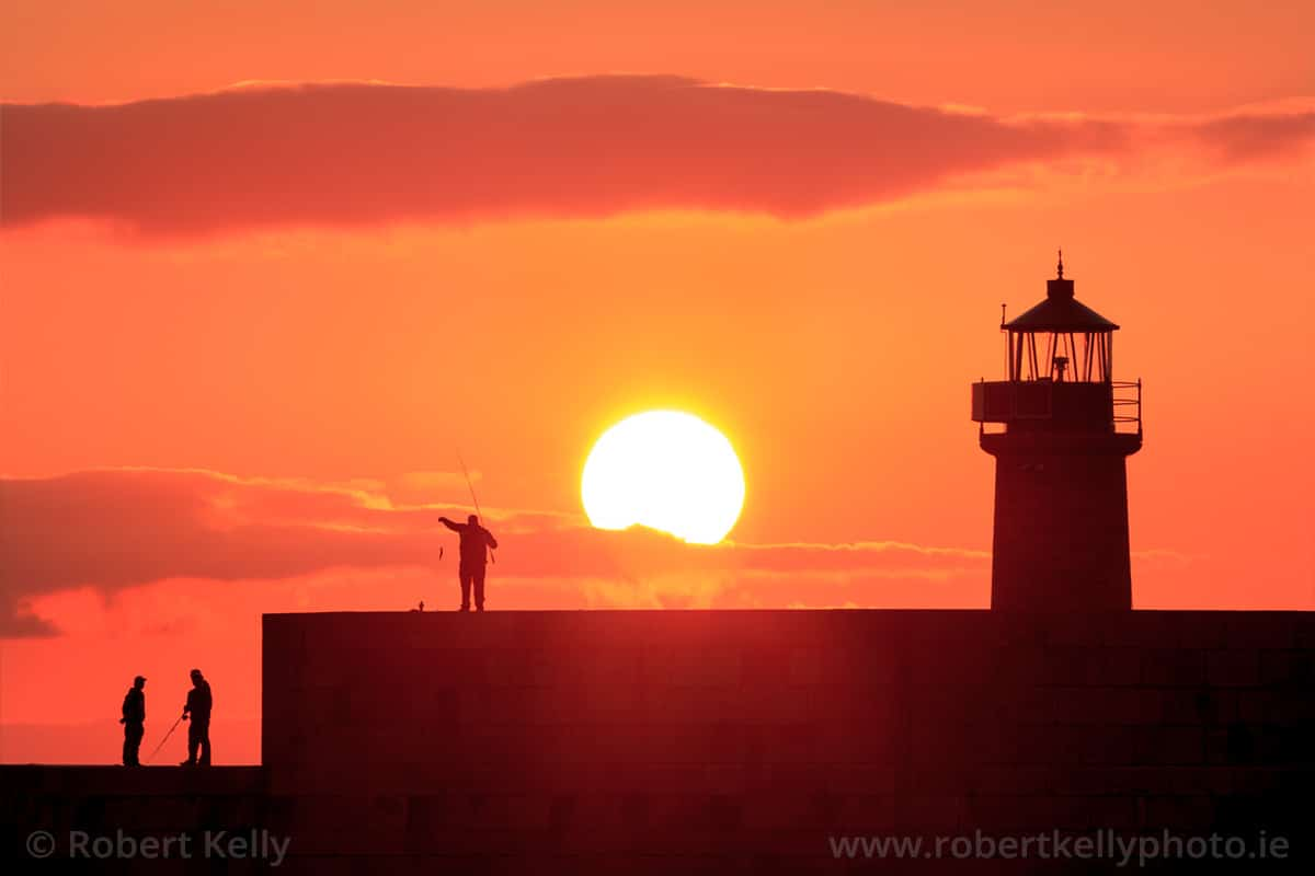 Fishing at Sunset at the West Pier Lighthouse, Dun Laoghaire, Dublin, Ireland